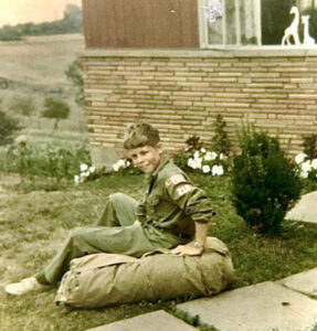 Doug sitting on law in Boy Scout uniform
