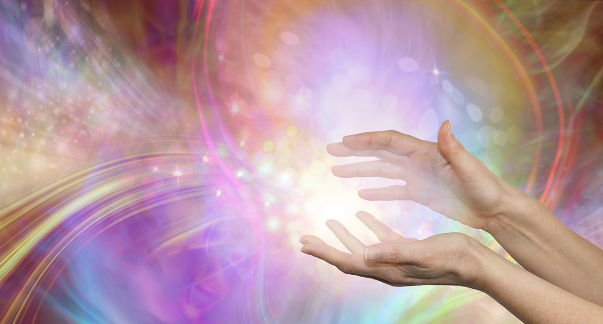 Hands with swirling energy around them